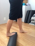 Calf stretch on yoga mat